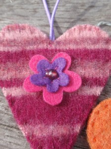 Striped pink felt heart close up